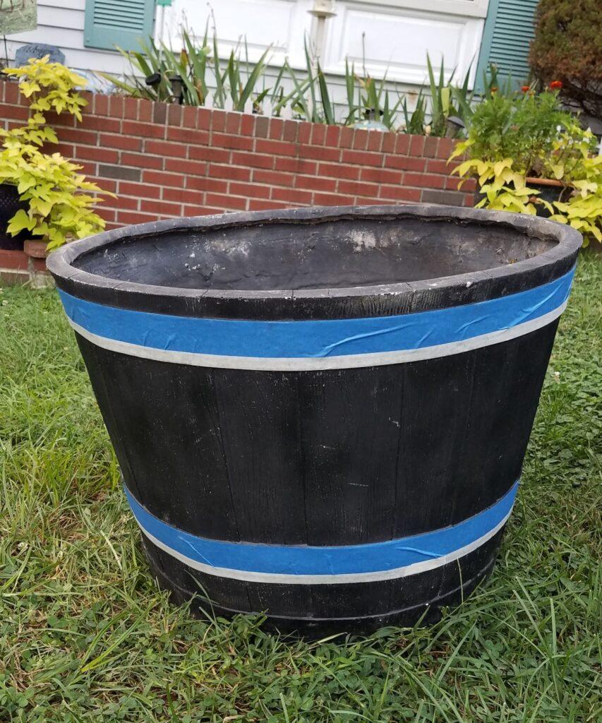 blue tape on black planter