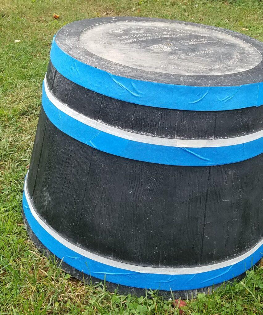 blue tape on upside down planter
