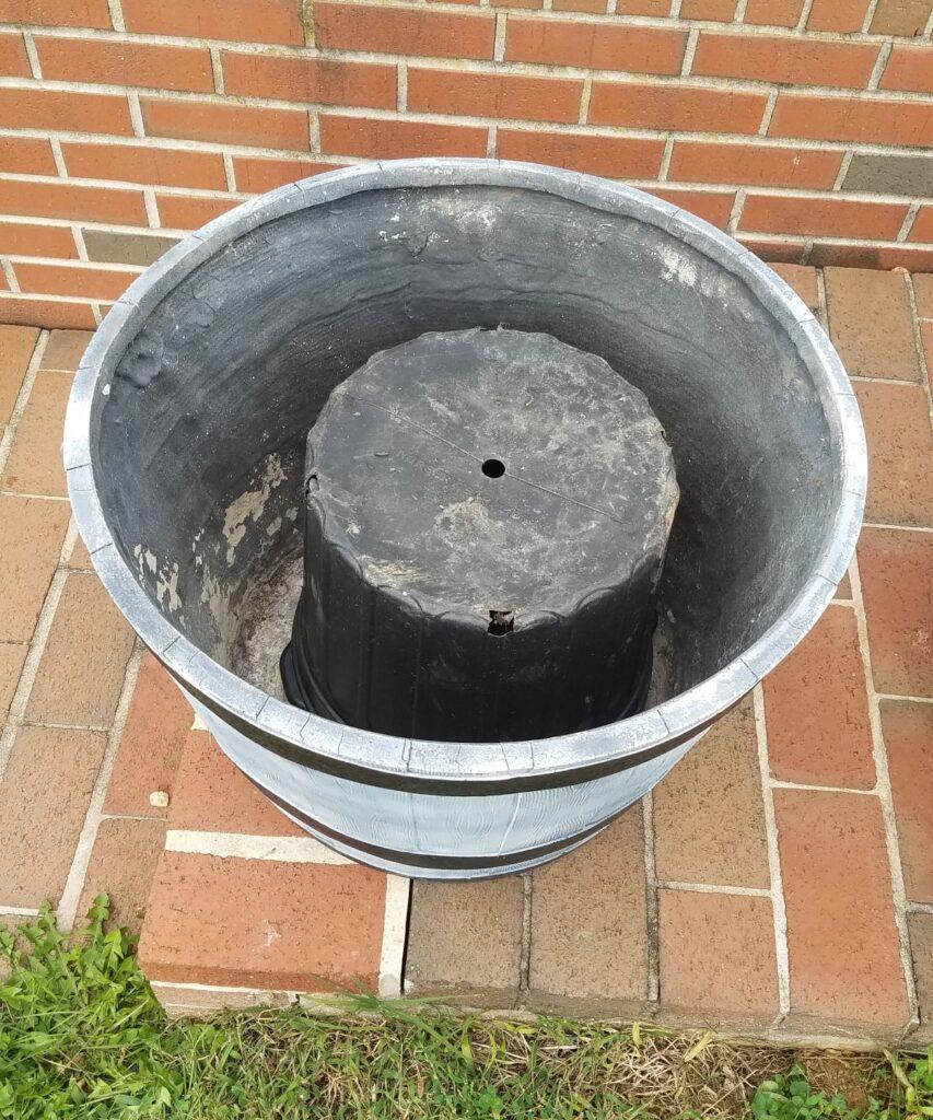bucket upside down in planter