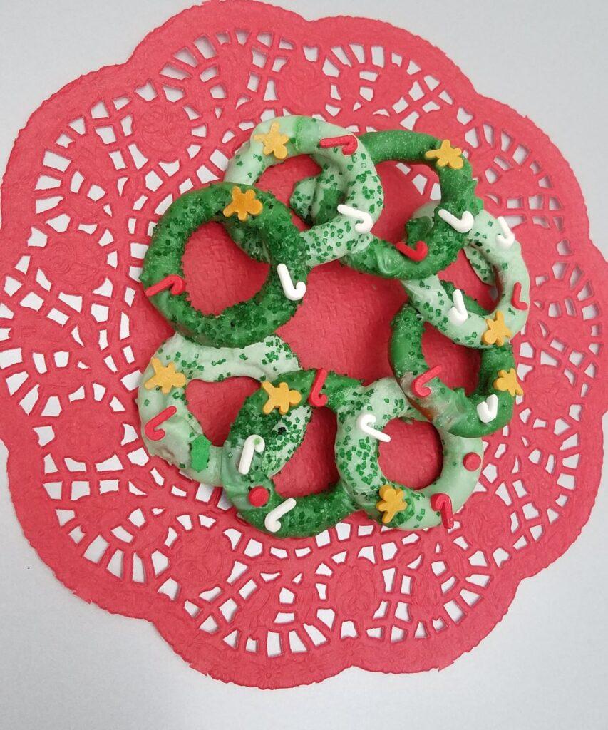 Christmas sprinkles on a chocolate covered pretzel