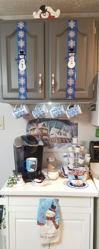 coffee station decorated with snowmen
