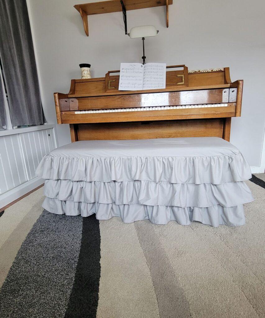 3 ruffles on a piano bench