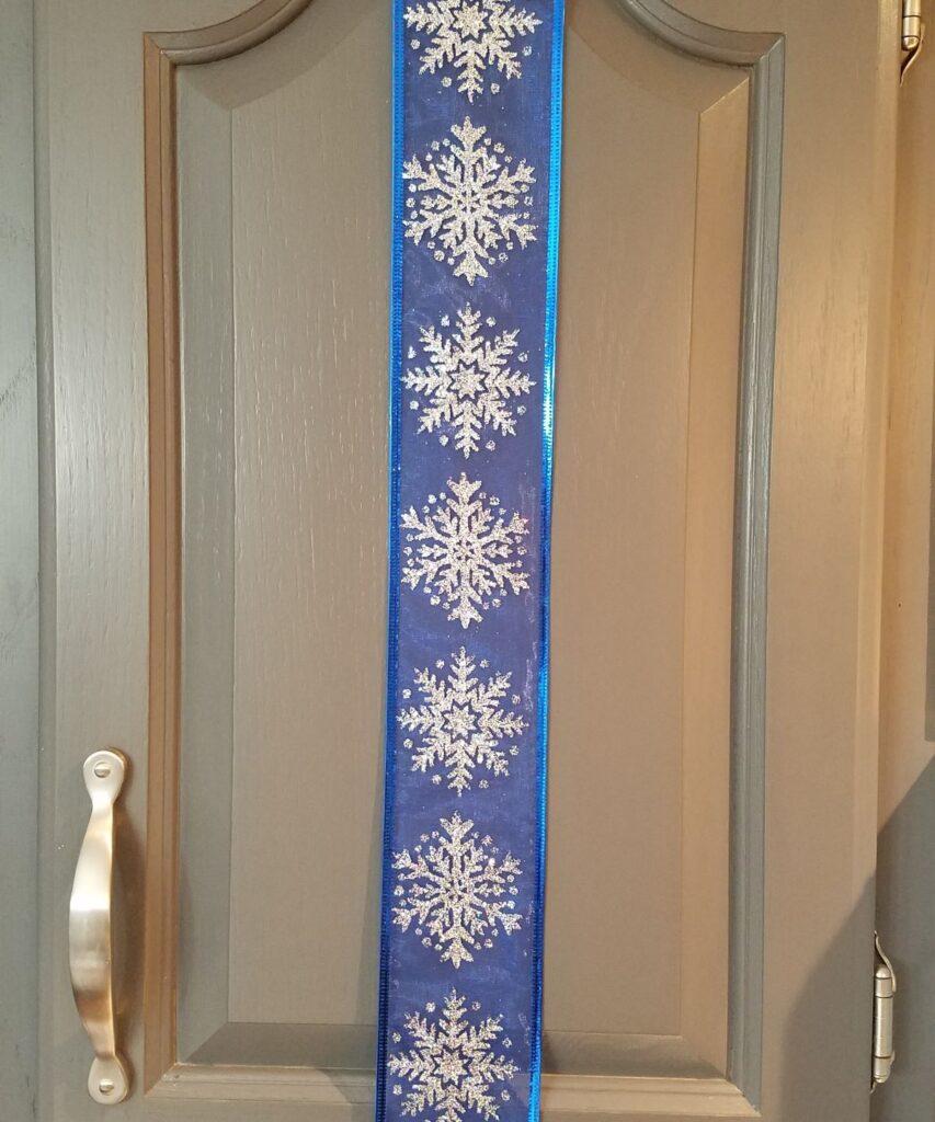 snowflakes on blue sheer ribbon