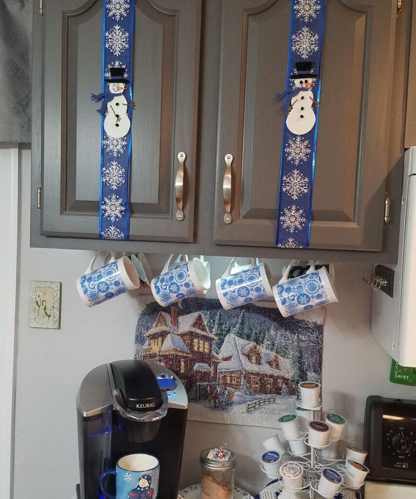 blue snowman decor on cabinets
