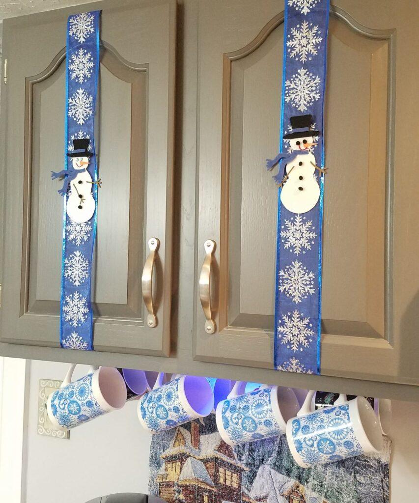 snowmen decor on gray cabinets