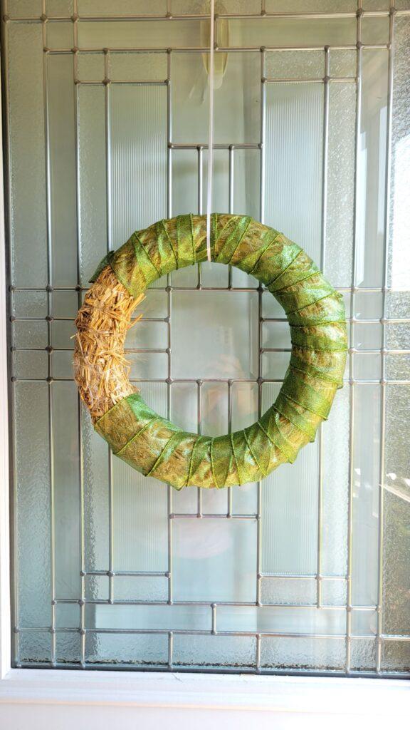 green ribbon on wreath