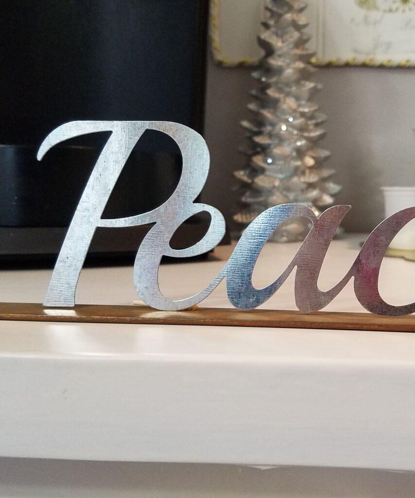 closeup of metal word Peace