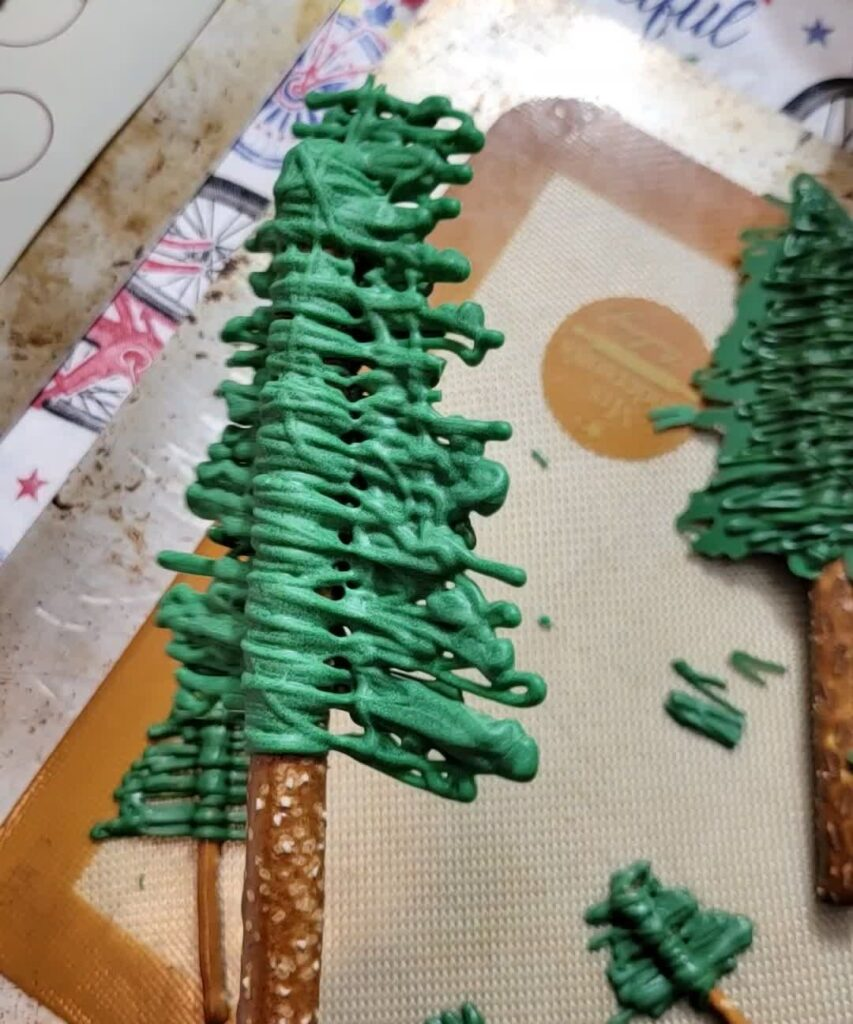 large tree made out of pretzel and green chocolate