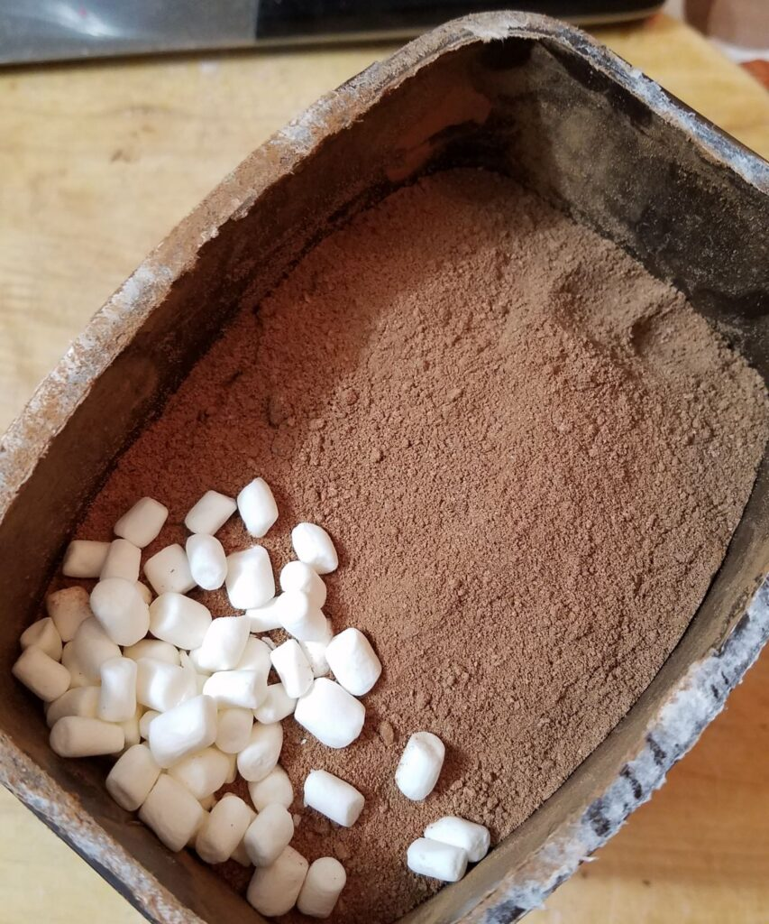 mini marshmallows in brown powder