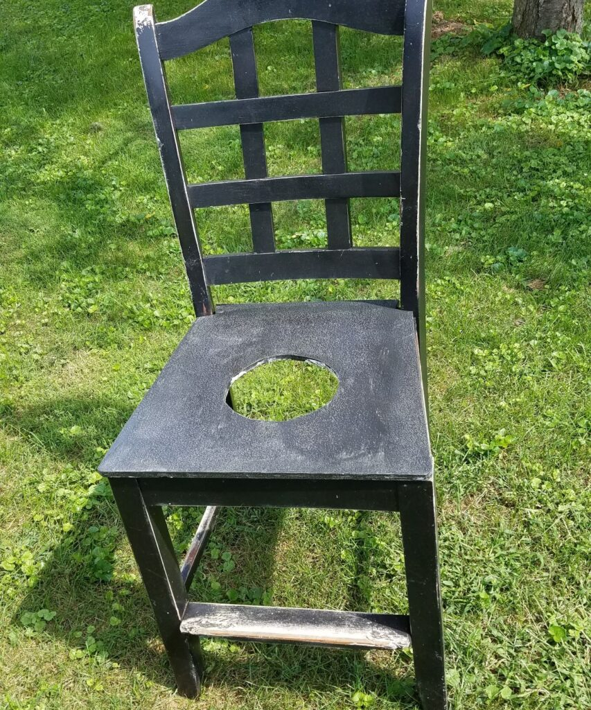 chair with a hole cut into the seat