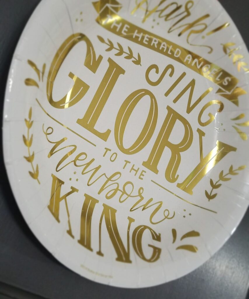 paper plate with gold words